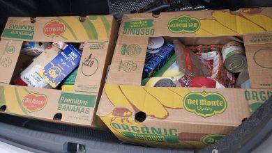 صورة توزيع مساعدات على المسنين والمحتاجين في جمعية ويندسور الإسلامية .